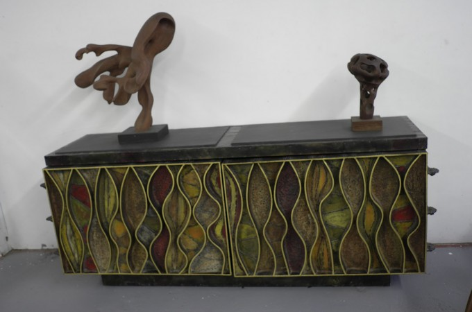 This is a Paul Evans studio wavy front buffet---good stuff and worth about 150k today