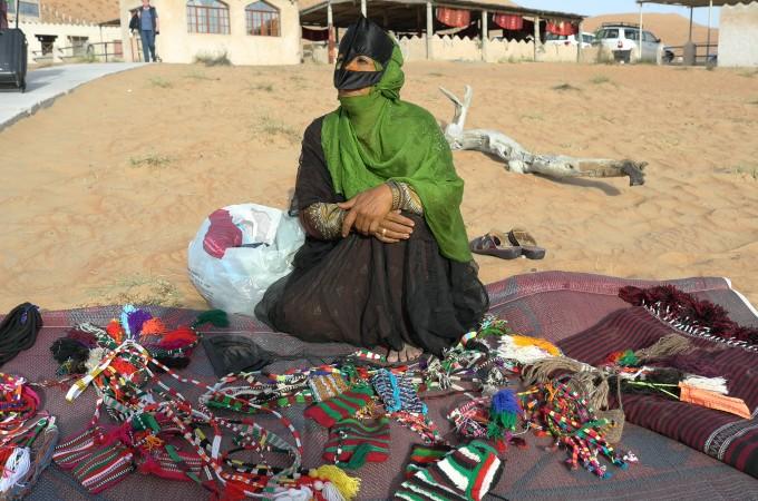 Bedouin lady sells some pretty stuff.