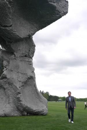 Emmanuel Perrotin dwarfed by the giant
