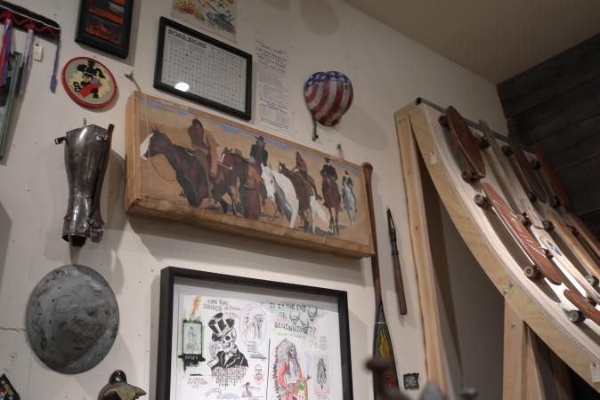 Check out the vintage safari hat, vintage skateboards, vintage paddles and Lang work on paper