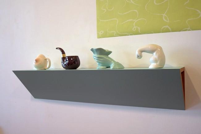 "Beautiful porcelain shelf: I'll call it ""Biceps and Breast"""