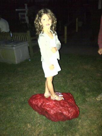 Little girl stands on Dan's work