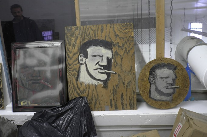 """Paul has collected hundreds of paintings by Robert Loughlin, his signature figure is known as the  """"brute"""". Loughlin was a famous furniture picker in the flea markets…he sold to Warhol, he was also a painter who painted the same figure on everything."""