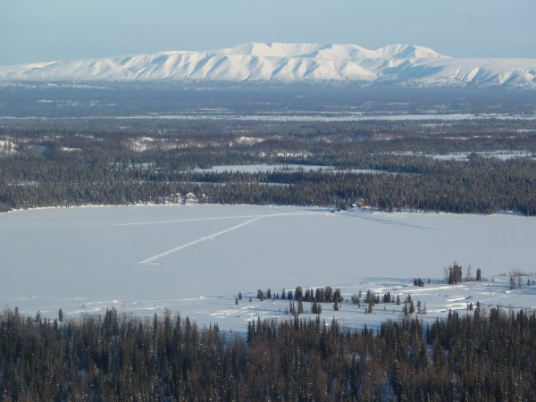 There's the wooden lodge in back, we're about to land on the frozen lake, cool!