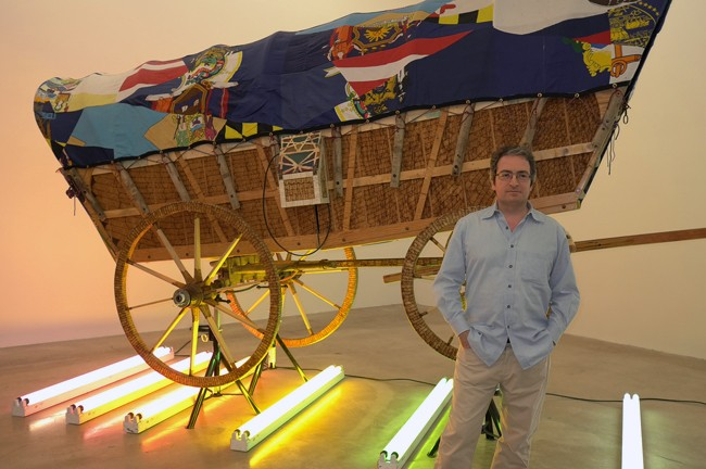 Look at Allen Djanogly, art poseur in front of Matthew Day Jackson's wagon from last year.