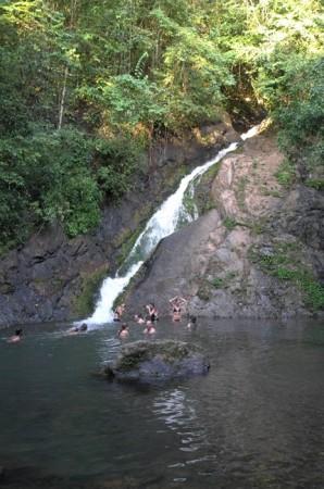 Bathing under a jungle waterfall.