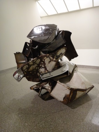 This is <em>Iron Stone</em>, it's from 1969 and was exhibited in the Guggenheim in 1971, so it's back visiting again. This is one of two works in the show with car parts crushing washing machines…it's killah.