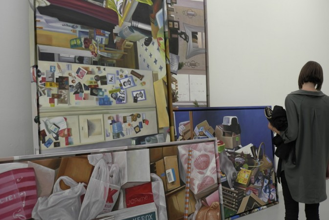 "I like the way the paintings are piled one on another ""hoarding"" style"