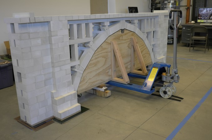 He's into primitive engineering and technological systems, like this 12-foot model of a bridge. It's self supporting without mortar or glue or any cement, it's engineered to stand up on its own, just a big toy for big boys.