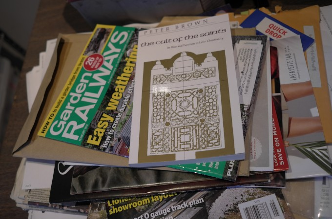 See his pile of books and manuals, look carefully and you will see books on how to build miniature railroads, skyscrapers, churches, perhaps…