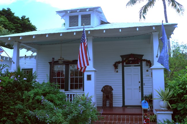 Taking the tourist train around Key West is fun… look at this old style Hemingway-era house.