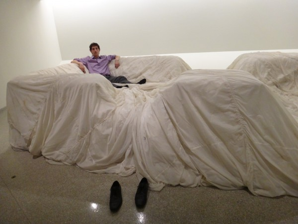 Some lazy punk took his shoes off at the opening and sat on the huge Chamberlain designed sofa! He's happy about it too. This is made of foam rubber covered by a parachute…cool!