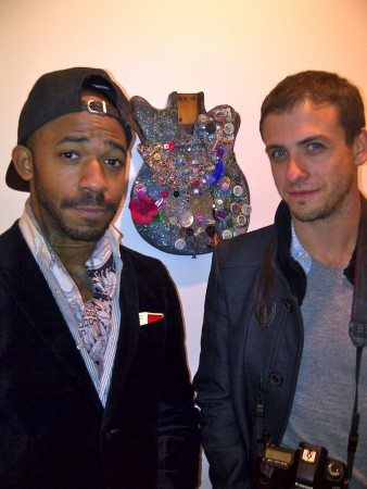 Hipster dudes in front of one bought by a major New York artist