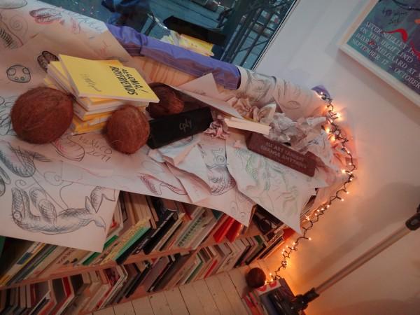 Melgaard drawings all over the bookshelf.