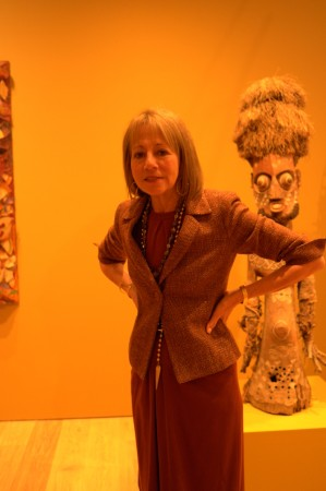 Lisa Dennison strikes a pose in front of a funky Papuan Gulf fetish