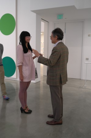 Now I'm in LA, looking at more spots. Cool! There's Jeffrey Deitch talking to a pretty girl.