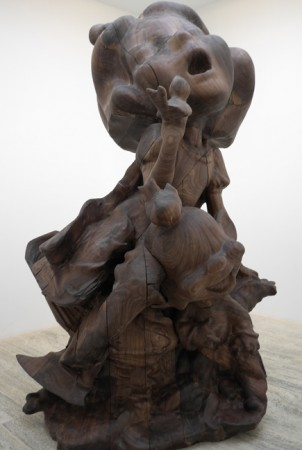 "Large wooden sculpture. I'll call it ""The Ecstasy."""